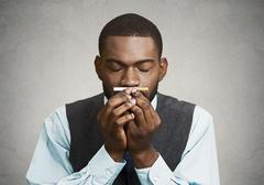 Man craving a cigarette - stock photo