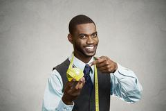 Happy executive advising on healthy diet, holding green apple - stock photo