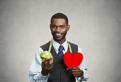 Closeup portrait, headshot business man, corporate executive holding green ap Stock Photos