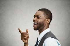 Headshot happy, laughing business man pointing finger at someone - stock photo
