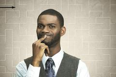 Closeup portrait puzzled serious business man thinking hard how find right so Stock Photos