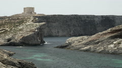 St Mary's Tower in Comino at Blue Lagoon in Malta Stock Footage