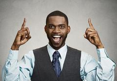 Excited businessman pointing with fingers up Stock Photos
