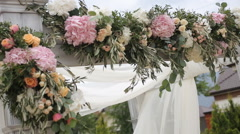 Wedding arch decorated with flowers before the wedding ceremony in the sky Stock Footage