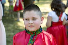 The boy in the Russian shirt during the holiday Stock Photos