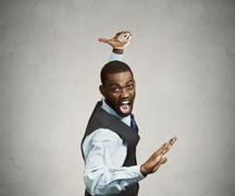 Angry executive man, negotiator in kakrate chop pose - stock photo