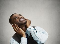 Upset man asking neighbor to stop making loud noise - stock photo