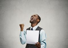 Angry customer, executive man screaming holding document, paper in hand Stock Photos
