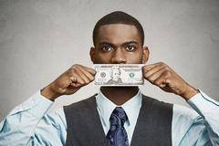 Bribery man with dollar bill on his mouth Stock Photos