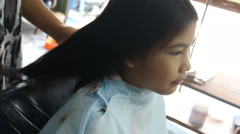 Hairdresser cutting client's hair in beauty salon, two shot - stock footage