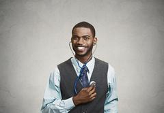 Executive man listening  to his heart, self criticism concept Stock Photos