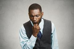 Man sticking finger in his mouth, feels sick, disgusted with situation - stock photo
