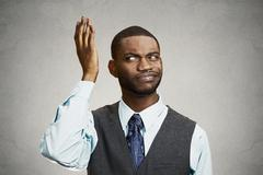 Confused, unhappy young businessman - stock photo