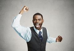 Excited happy man celebrates success, good outcome Stock Photos