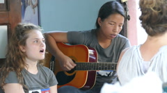 Youth Missions Team Singing Worship Songs Together Overseas Stock Footage