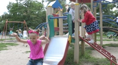 Boys and girls play together on the playground in the park Stock Footage