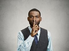 Secret man, finger on lips gesture Stock Photos