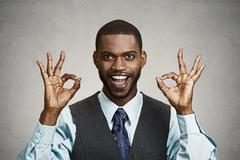 Business man giving ok sign - stock photo
