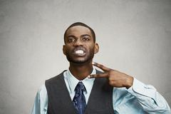 Angry executive man gesturing with hands to stop, cut it out - stock photo