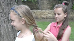Girlfriend braided pigtails to each other Stock Footage