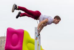 "Man performs a trick ""Battle Barstylers Workout"" on Freedom Square in Kharkov Stock Photos"