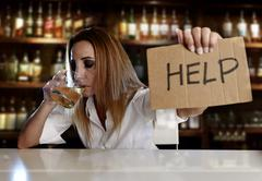 Drunk blond alcoholic woman asking for help Stock Photos