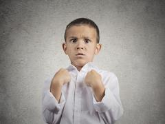 surprised boy getting unexpected attention asking you talking to me? - stock photo