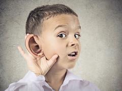 Nosy little boy, man listening carefully to someone's secrets Stock Photos