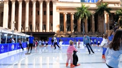 Winter Festival in Brisbane, outdoor ice-skating, King George Square Stock Footage