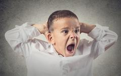 Angry boy screaming Stock Photos