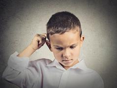 Thinking child, scratching back of his head Stock Photos