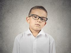 Boy with judgmental face expression Stock Photos