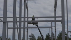 Construction worker standing in a skylift Stock Footage