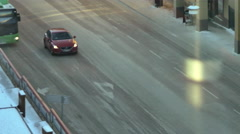 Car driving up the street in a small town Stock Footage