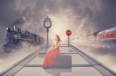 Woman waiting old train on platform of railway station talking on phone Kuvituskuvat