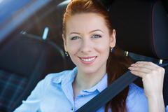 Buckle up. Woman inside black car follows  traffic rules Stock Photos