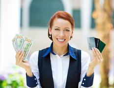 Bank agent showing convinience of electronic money Stock Photos
