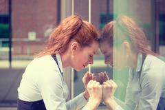 portrait stressed sad young woman outdoors. Urban life style stress - stock photo