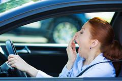 Sleepy fatigued driver, driving car Stock Photos