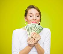 Woman loves money Stock Photos