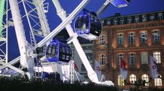 Ferris wheel at night on a dark blue sky Stock Footage