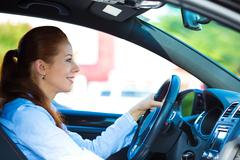 Happy car driver woman smiling - stock photo