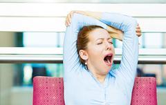 Sleepy business woman - stock photo