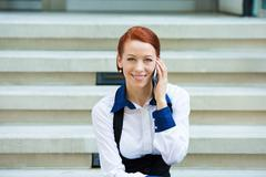 Portrait corporate woman talking on smart phone - stock photo