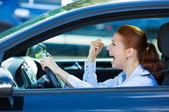Angry, screaming female car driver Stock Photos