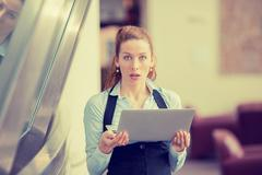 Shocked woman with computer laptop Stock Photos