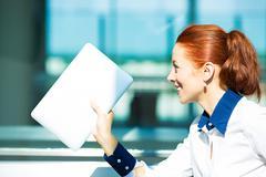 Businesswoman running late - stock photo