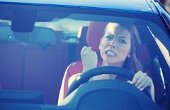 Angry aggressive woman driving car Stock Photos