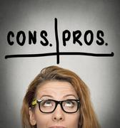 Pros and cons, for and against argument concept Stock Photos