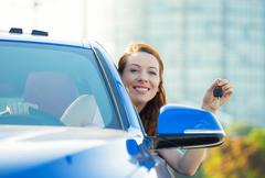 Happy, smiling, young attractive woman, buyer sitting in her new blue car Stock Photos